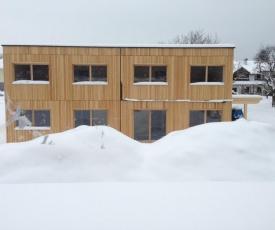 BIO-Vollholzhaus mit Badeplatz